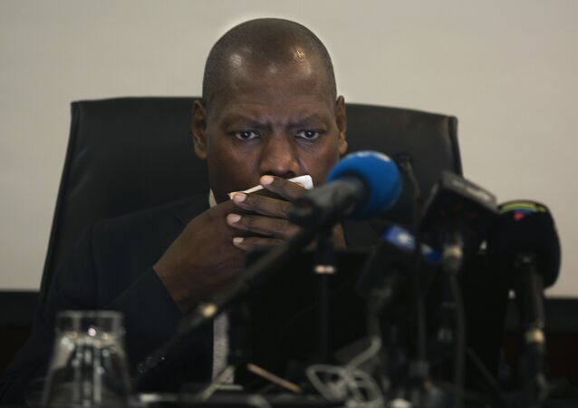 South Africa's Health Minister Zweli Mkhize speaks at a news conference in Johannesburg, Sunday, March 1, 2020.