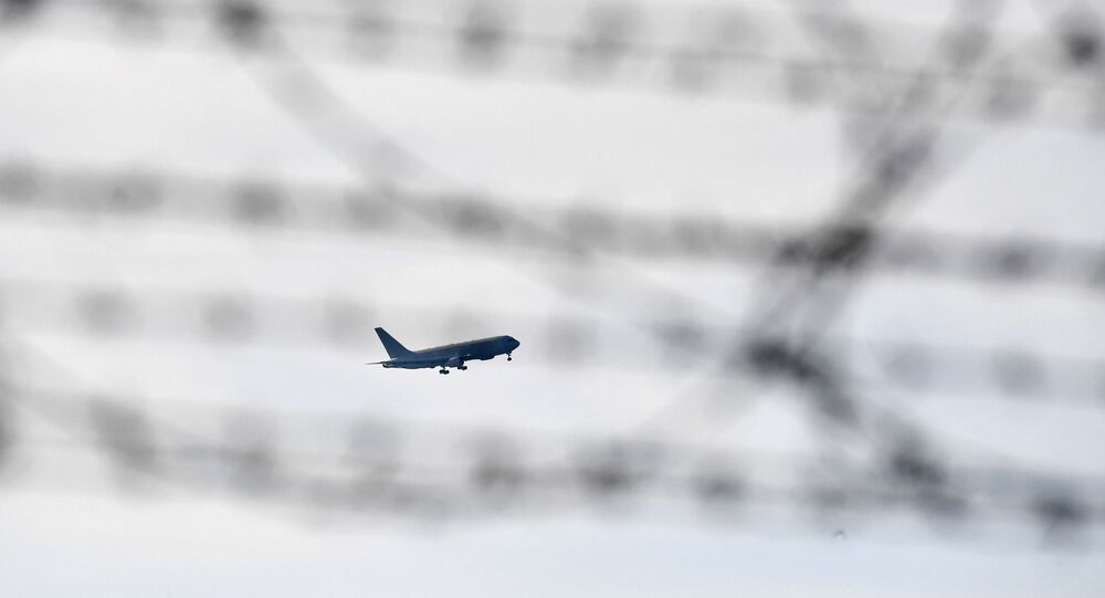 An Italian Boeing KC-767 military aerial refueling and strategic transport aircraft, transporting Italian citizens repatriated from the coronavirus hot-zone of Wuhan and to be placed in quarantine, prepares to land at the Mario De Bernardi military airport in Pratica di Mare, south of Rome, on February 3, 2020.