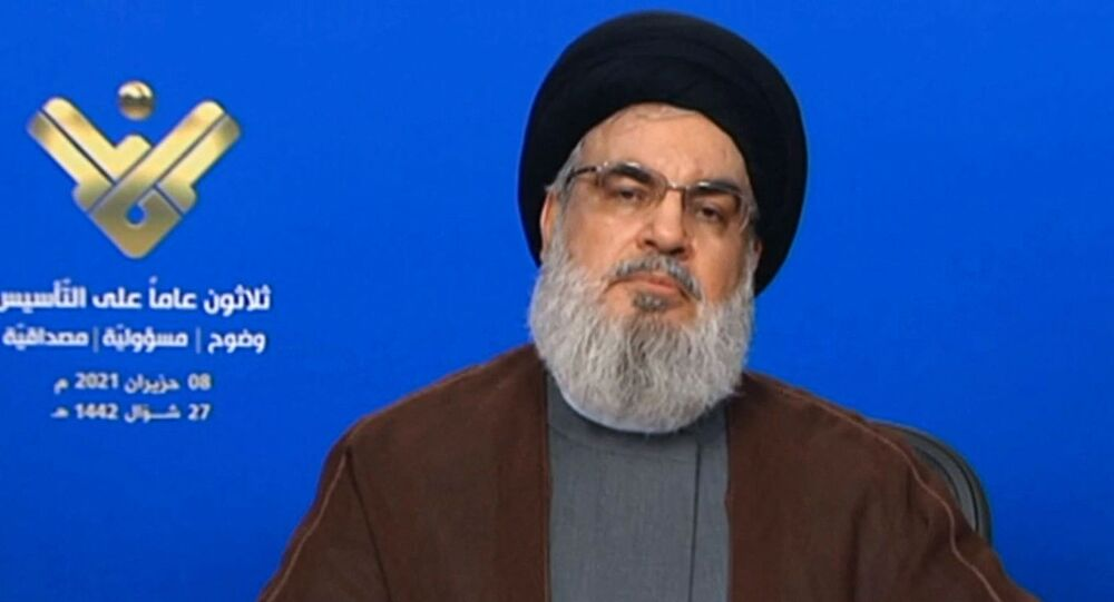 An image grab taken from Hezbollah's al-Manar TV on June 8, 2021, shows the leader of the Lebanese Shiite party Hassan Nasrallah delivering a televised speech from an undisclosed location to mark the anniversary of the TV network.