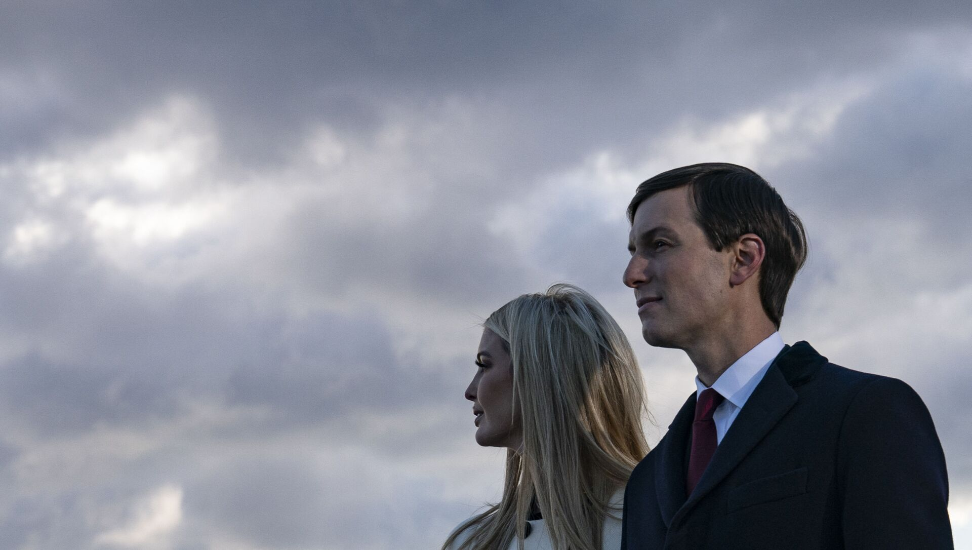 Daughter and Senior Advisor to the Outgoing US President Ivanka Trump and husband Senior Advisor to the Outgoing President Jared Kushner stand on the tarmac at Joint Base Andrews in Maryland as they attend US President Donald Trump's departure on January 20, 2021. - Sputnik International, 1920, 08.06.2021