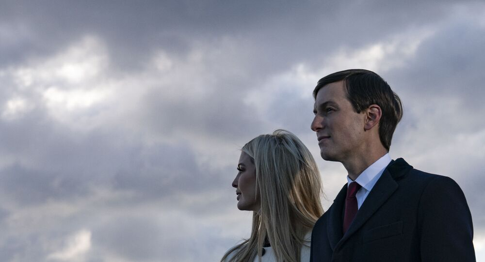 Daughter and Senior Advisor to the Outgoing US President Ivanka Trump and husband Senior Advisor to the Outgoing President Jared Kushner stand on the tarmac at Joint Base Andrews in Maryland as they attend US President Donald Trump's departure on January 20, 2021.