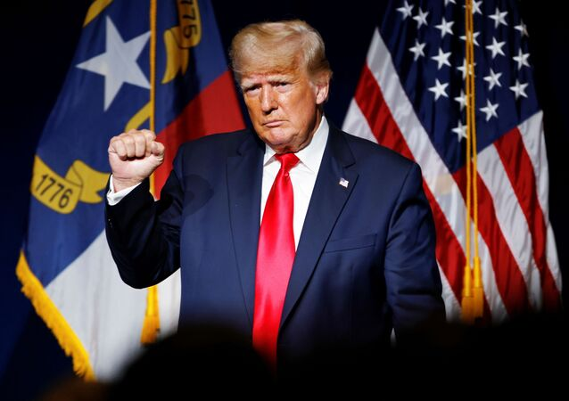 Former U.S. President Donald Trump makes a fist while reacting to applause after speaking at the North Carolina GOP convention dinner in Greenville, North Carolina, U.S. June 5, 2021.