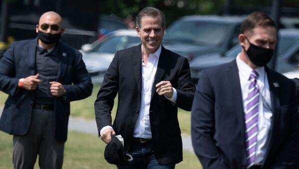 Hunter Biden walks to Marine One on the Ellipse outside the White House May 22, 2021, in Washington, DC. - Sputnik International