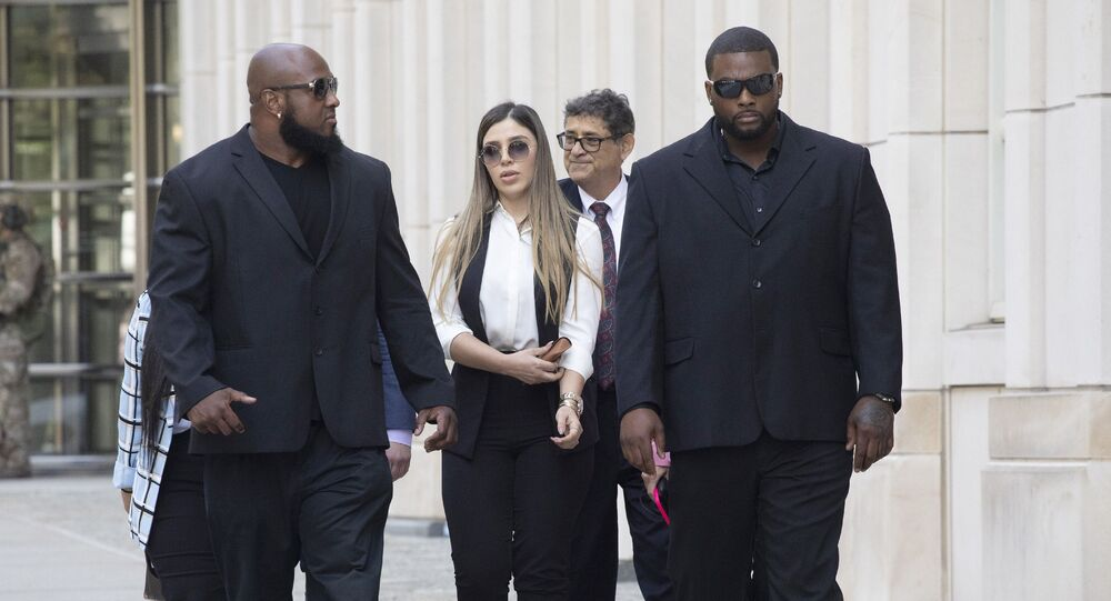 In this July 17, 2019 file photo, New York City police officer Ishmael Bailey, right, moonlights as a bodyguard for Emma Coronel Aispuro, wife of Mexican drug lord Joaquin El Chapo Guzman, as they leave Brooklyn federal court in New York, following Guzman's sentencing.
