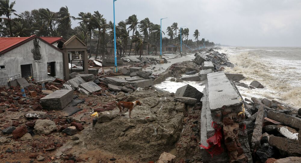A dog walks on the debris of the damaged tourist lodges along a beach front following Cyclone Yaas in Shankarpur, Purba Medinipur district in the eastern state of West Bengal, India, May 27, 2021