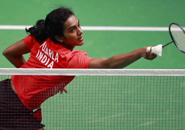 India's P.V. Sindhu returns the ball to Vietnam's Vu Thi Trang during their women's single badminton match at 18th Asian Games in Jakarta, Indonesia, Thursday, Aug. 23, 2018
