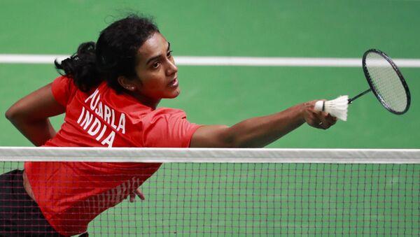 India's P.V. Sindhu returns the ball to Vietnam's Vu Thi Trang during their women's single badminton match at 18th Asian Games in Jakarta, Indonesia, Thursday, Aug. 23, 2018 - Sputnik International