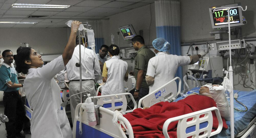 Indian nurses tend to patients at a government hospital in New Delhi (File)