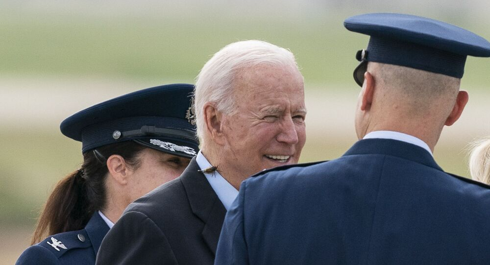 President Joe Biden, with a brood X cicada on his back, walks to board Air Force One upon departure, Wednesday, June 9, 2021, at Andrews Air Force Base, Md. Biden is embarking on the first overseas trip of his term, and is eager to reassert the United States on the world stage, steadying European allies deeply shaken by his predecessor and pushing democracy as the only bulwark to the rising forces of authoritarianism.