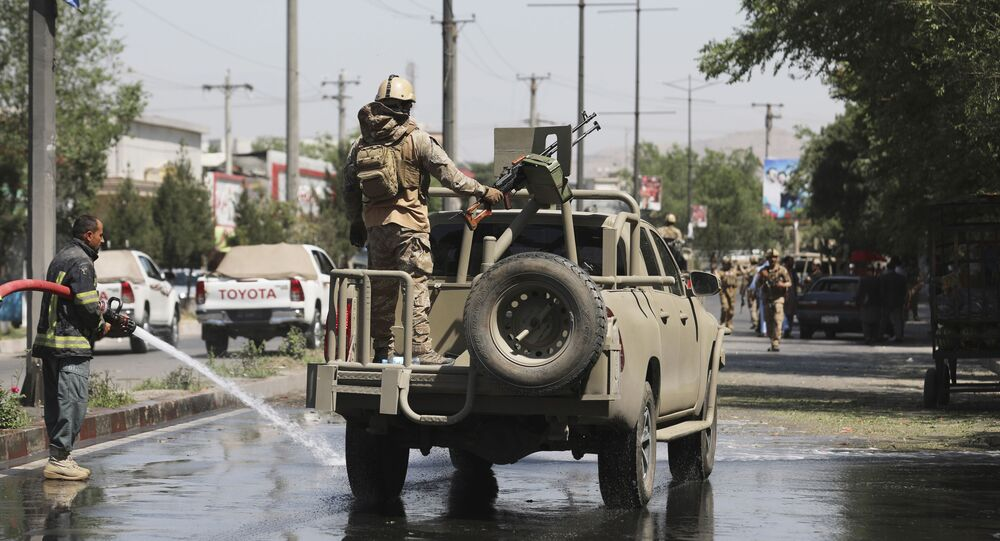 Afghan security personnel leave the scene of a roadside bomb explosion in Kabul, Afghanistan, Sunday, 6 June 2021.