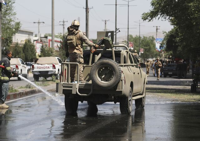 Afghan security personnel leave the scene of a roadside bomb explosion in Kabul, Afghanistan, Sunday, June 6, 2021.