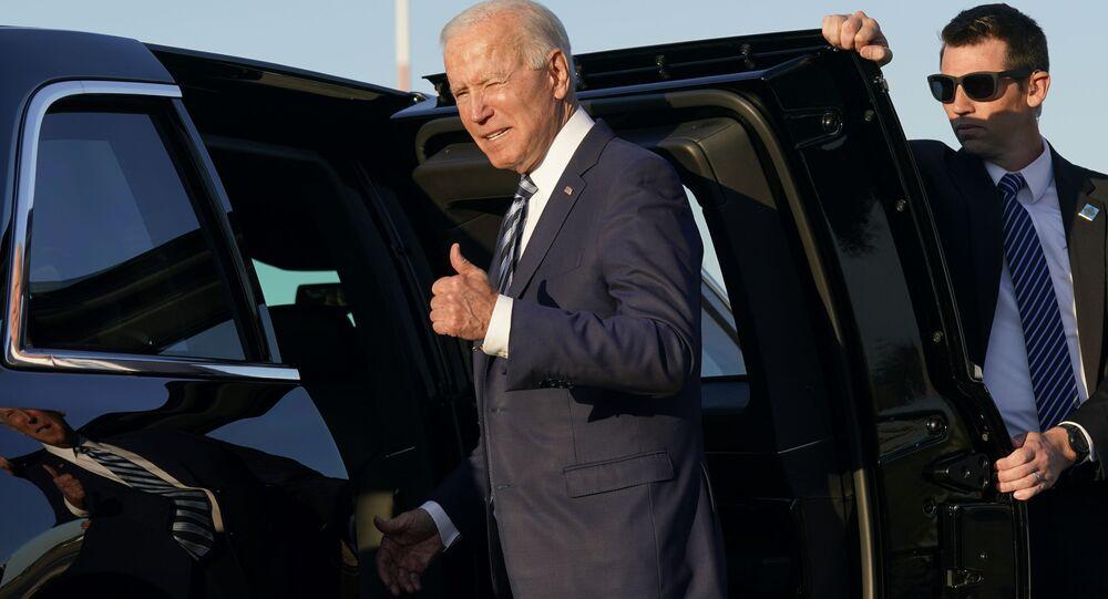 President Joe Biden steps into a motorcade vehicle after arriving at RAF Mildenhall in Suffolk, England, Wednesday, June 9, 2021.