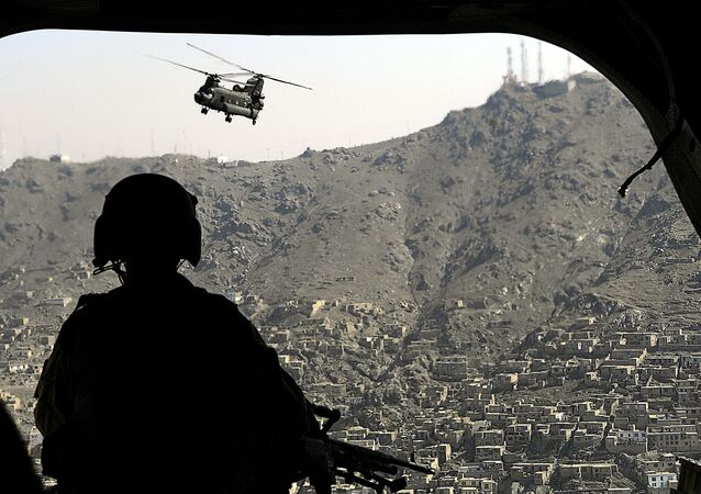 A CH-47 Chinook helicopter flies over Kabul, Afghanistan, June 4, 2007.  DoD photo by Cherie A. Thurlby.