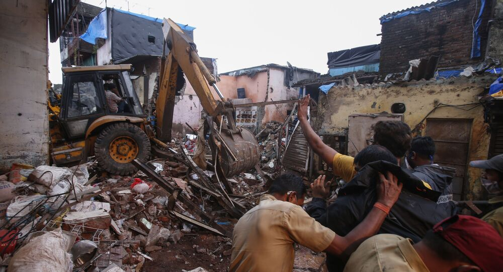 Rescuers clear the debris to find any residents possibly still trapped after a three-story dilapidated building collapsed following heavy monsoon rains n Mumbai, India, Thursday, June 10, 2021