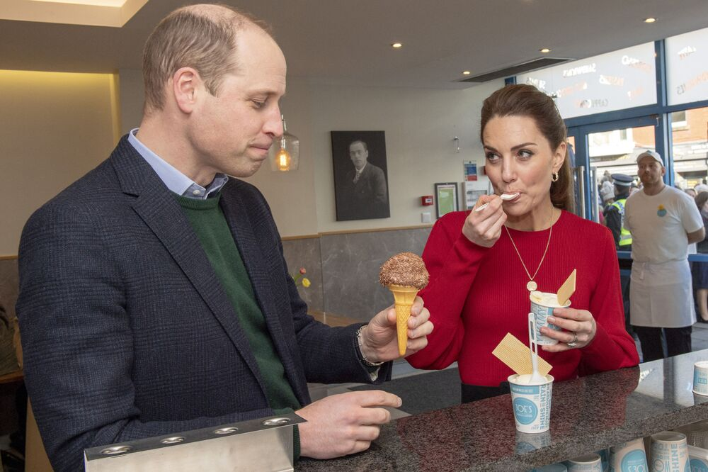 Britain's Prince William, Duke of Cambridge and his wife Catherine, Duchess of Cambridge taste ice cream during a visit to Joe's Ice Cream Parlour in Mumbles, south Wales on 4 February 2020.