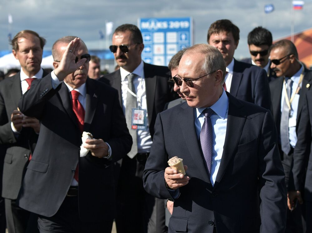 Russian President Vladimir Putin and Turkish President Recep Tayyip Erdogan eat ice cream during the MAKS-2019 air show in the Moscow region.