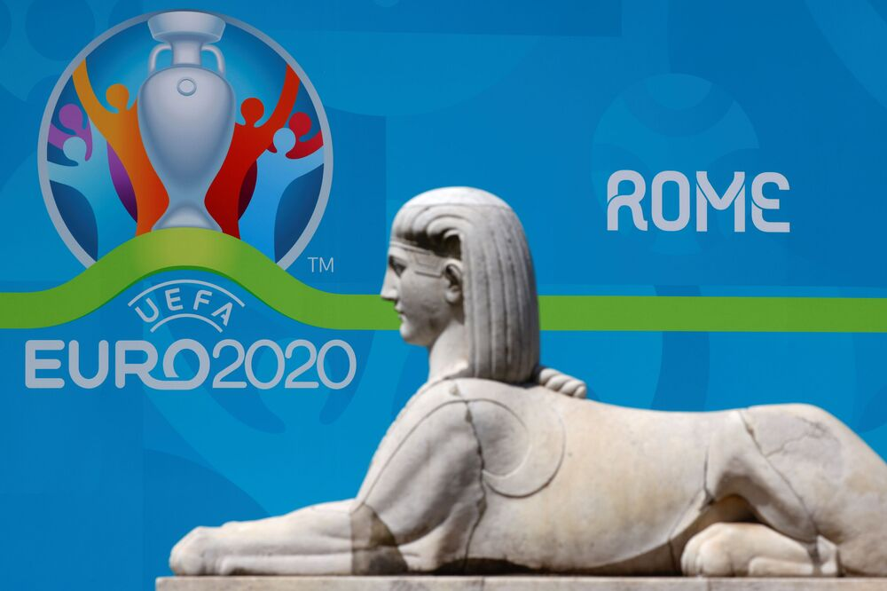 The logo of UEFA Euro 2020 is seen behind a statue at the fan zone at Piazza del Popolo in Rome, Italy, 7 June 2021.