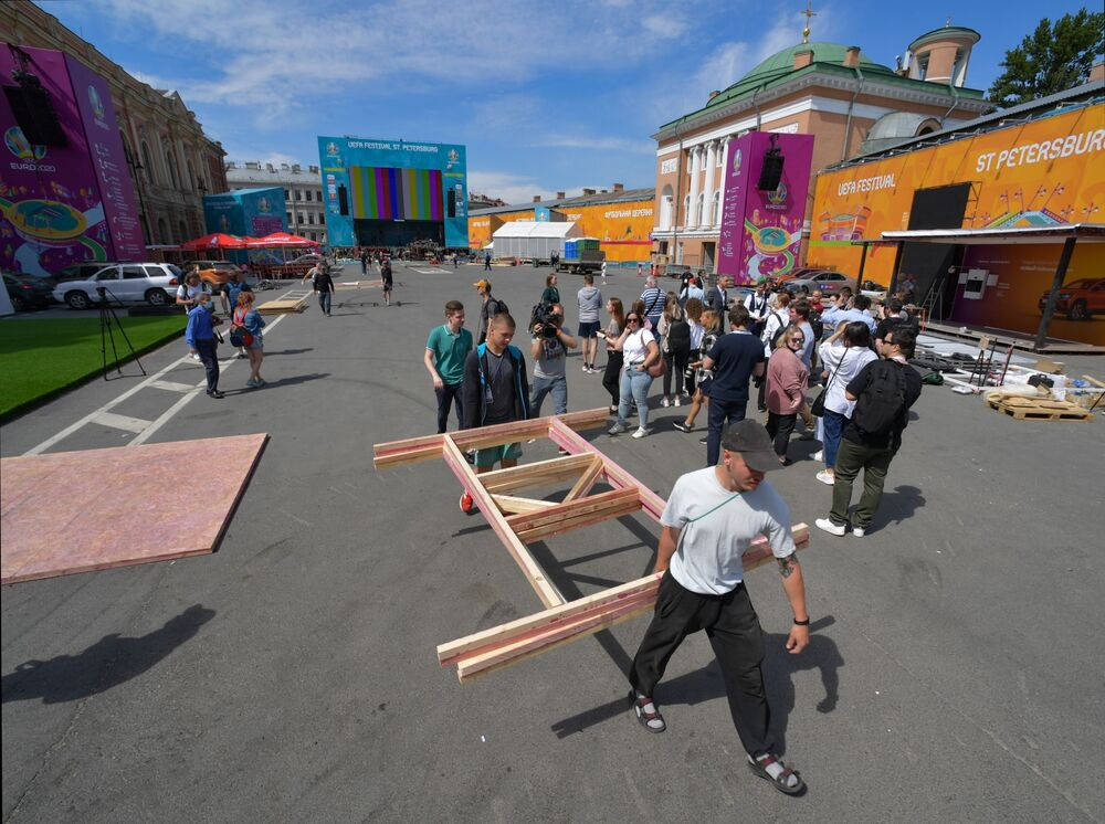 Workers assemble parts of the UEFA European Championship Football Village in Russia's St. Petersburg as the city is getting ready to host the tournament for the first time.