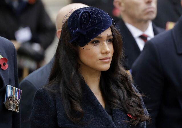 In this Thursday, Nov. 7, 2019 file photo Meghan the Duchess of Sussex stands after she and her husband Britain's Prince Harry placed a Cross of Remembrance as they attend the official opening of the annual Field of Remembrance at Westminster Abbey in London
