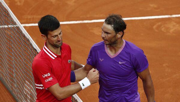Tennis - ATP Masters 1000 - Italian Open - Foro Italico, Rome, Italy - May 16, 2021 Spain's Rafael Nadal shakes hands with Serbia's Novak Djokovic after winning the final - Sputnik International