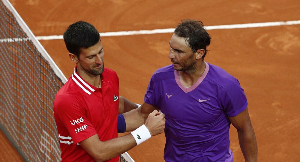 Tennis - ATP Masters 1000 - Italian Open - Foro Italico, Rome, Italy - May 16, 2021 Spain's Rafael Nadal shakes hands with Serbia's Novak Djokovic after winning the final