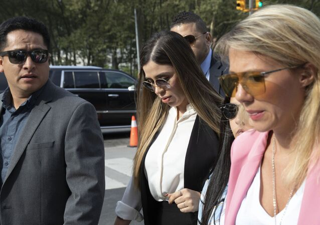 In this July 17, 2019 file photo, Emma Coronel Aispuro, center, wife of Mexican drug lord Joaquin El Chapo Guzman, arrives for his sentencing at Brooklyn federal court, in New York. According to the United States Department of Justice, Coronel has been arrested on Monday, Feb. 22, 2021, under drug trafficking charges