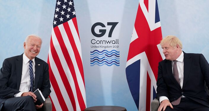 U.S. President Joe Biden laughs while speaking with Britain's Prime Minister Boris Johnson during their meeting, ahead of the G7 summit, at Carbis Bay, Cornwall, Britain June 10