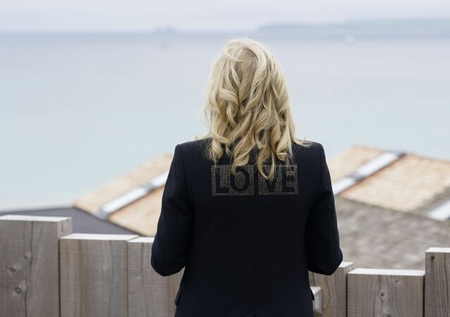 First lady Jill Biden turns around to show the word love on the back of her jacket as she speaks with reporters after visiting with Carrie Johnson, wife of British Prime Minister Boris Johnson, ahead of the G-7 summit, Thursday, June 10, 2021, in Carbis Bay, England.
