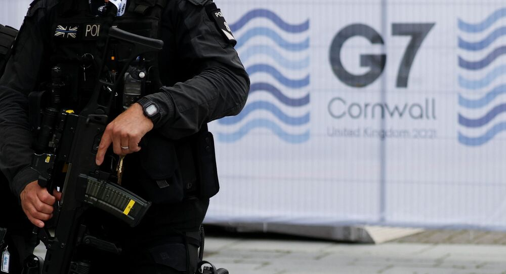 Armed police officers walk in Falmouth as preparations are underway for the G7 leaders summit, Cornwall, Britain, June 10, 2021.