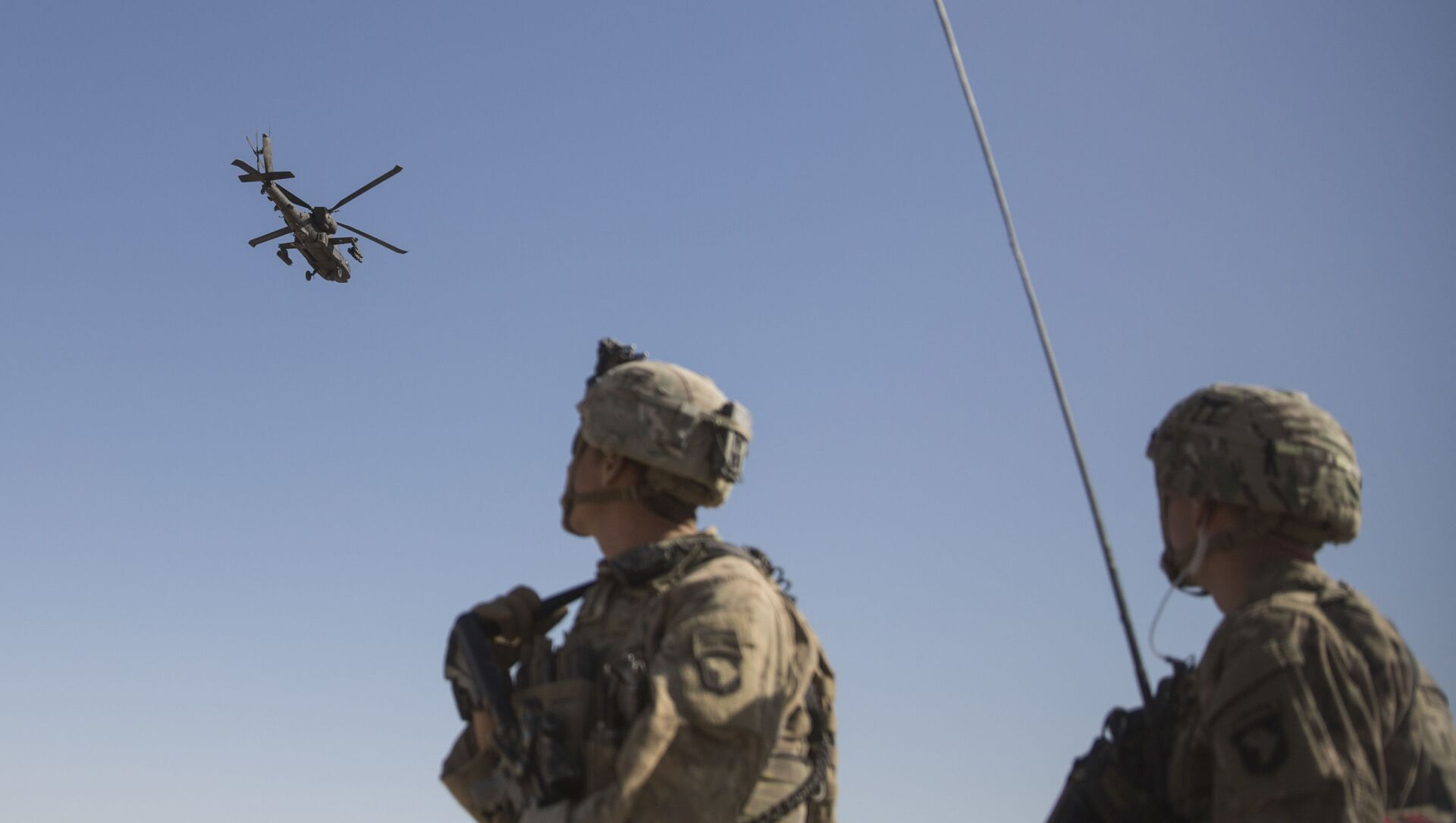 This June 10, 2017 photo released by the U.S. Marine Corps shows an AH-64 Apache attack helicopter provides security from above while CH-47 Chinooks drop off supplies to U.S. Soldiers with Task Force Iron at Bost Airfield, Afghanistan. - Sputnik International, 1920, 19.06.2021