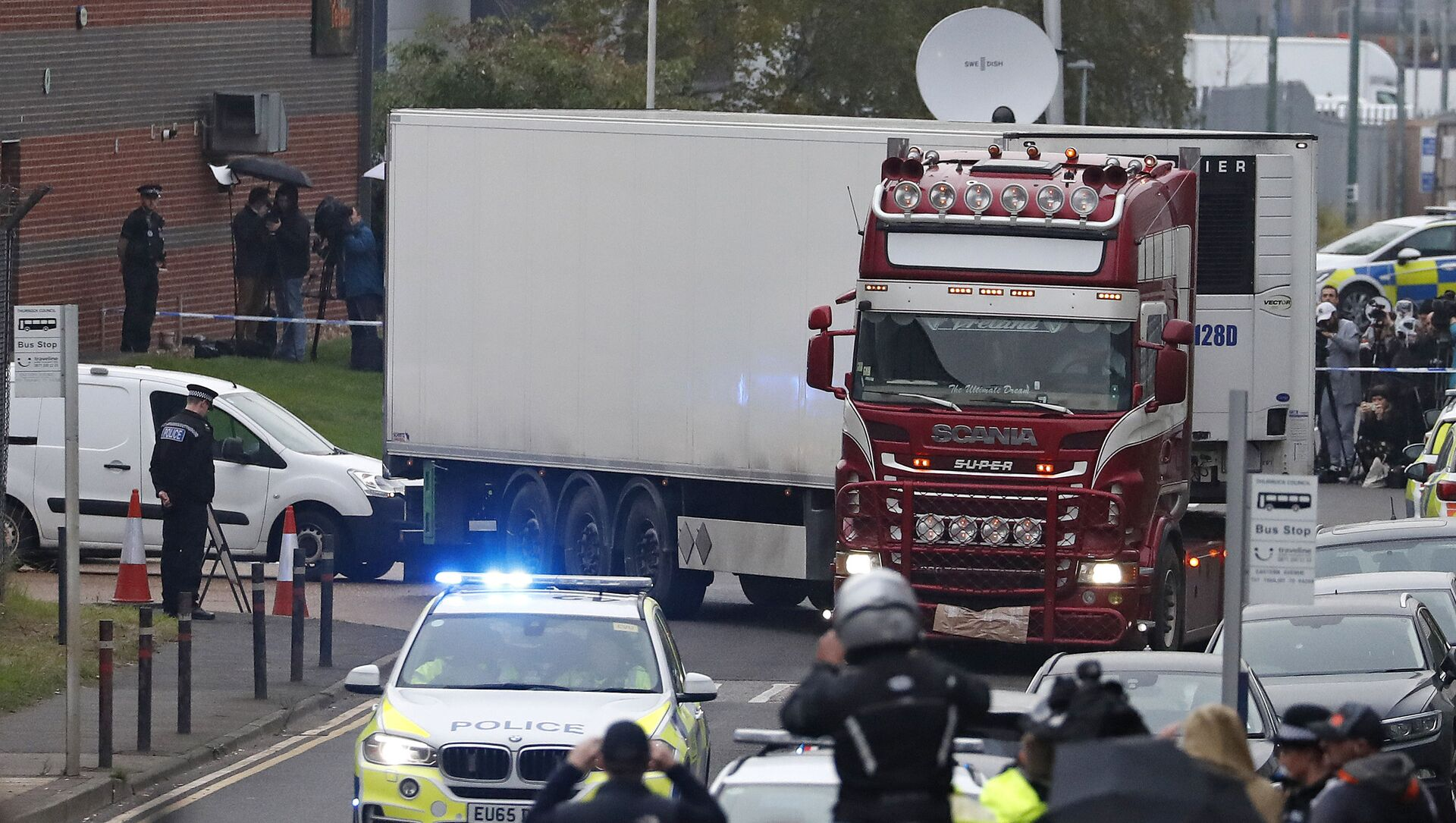 In this Wednesday Oct. 23, 2019 file photo, police escort the truck, that was found to contain a large number of dead bodies, as they move it from an industrial estate in Thurrock, south England - Sputnik International, 1920, 23.07.2021