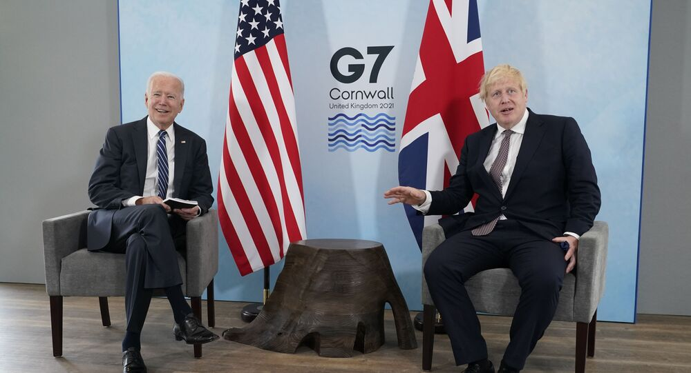President Joe Biden and British Prime Minister Boris Johnson visit during a bilateral meeting ahead of the G-7 summit, Thursday, June 10, 2021, in Carbis Bay, England