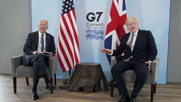 President Joe Biden and British Prime Minister Boris Johnson visit during a bilateral meeting ahead of the G-7 summit, Thursday, June 10, 2021, in Carbis Bay, England - Sputnik International