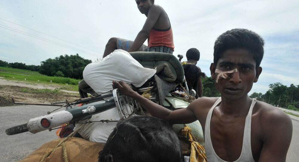 Indian Muslim villagers move to relief camps from Gosaigaon village, at Kokrajhar district in the northeastern state of Assam on July 26, 2012