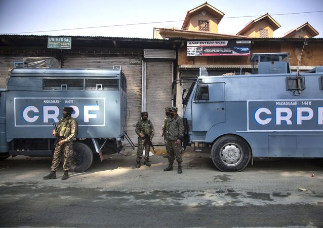 Indian Central Reserve Police Force (CRPF) soldiers guard during a gunfight between Indian government forces and suspected rebels in Srinagar, Indian controlled Kashmir, Monday, Oct. 12, 2020