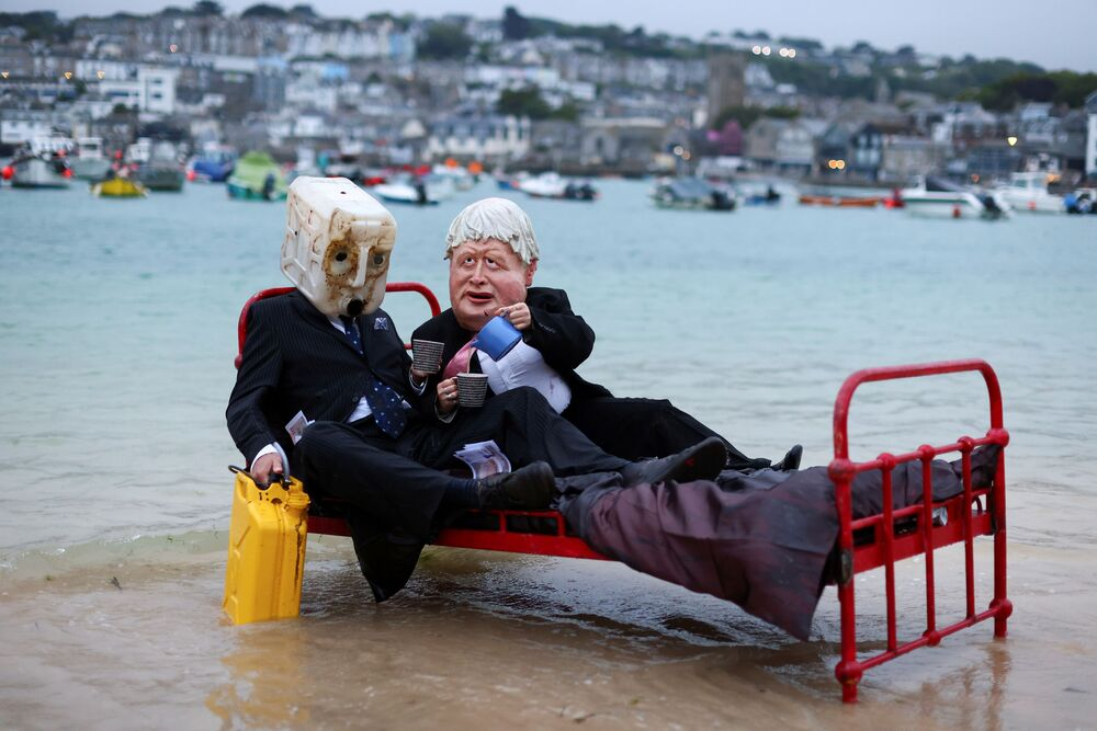 Activists from the climate action group Ocean Rebellion demonstrate in St Ives Harbour, ahead of the G7 summit, in St Ives, Cornwall, Britain, 9 June 2021.