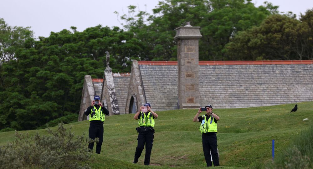 Police officers use their mobile phones in Falmouth, on the sidelines of G7 summit in Cornwall, Britain, June 11, 2021.
