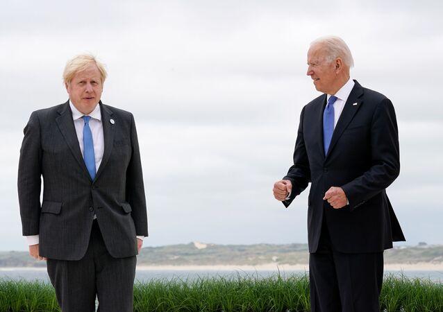 British Prime Minister Boris Johnson and U.S. President Joe Biden pose for photos at the G-7 summit, in Carbis Bay, Cornwall, Britain June 11, 2021