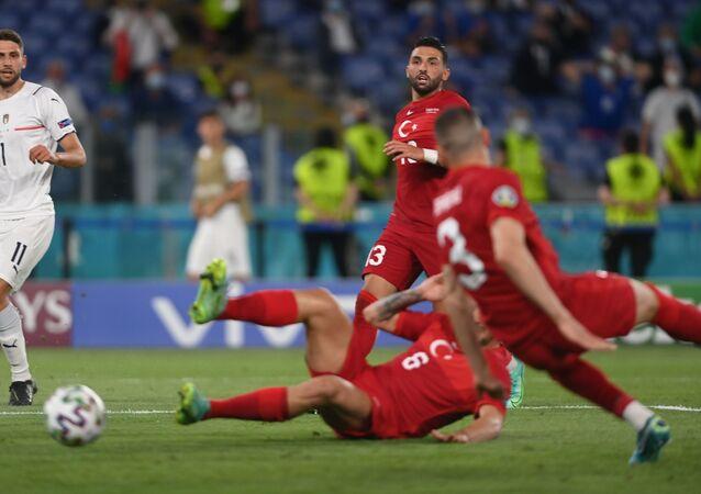 Turkey's Umut Meras looks on at Merih Demiral scores an own goal