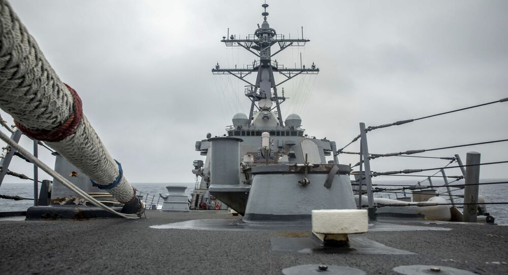 In this photo released by the U.S. Navy, the U.S. Arleigh Burke-class guided-missile destroyer USS Curtis Wilbur (DDG 54) conducts routine operations in the Taiwan Strait, May 18, 2021.