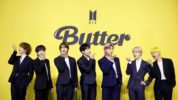 Members of K-pop boy band BTS pose for photographs during a photo opportunity promoting their new single 'Butter' in Seoul - Sputnik International