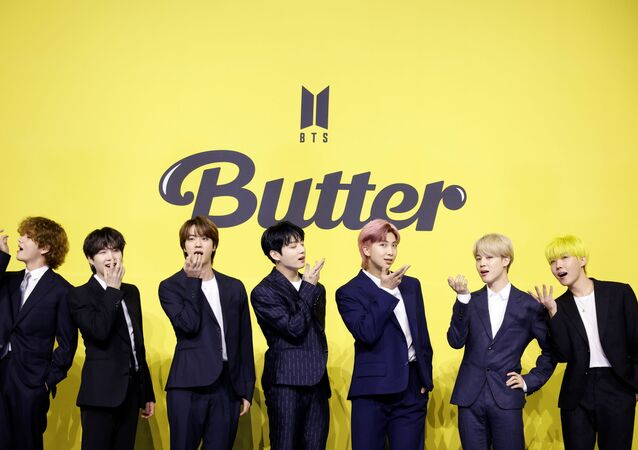 Members of K-pop boy band BTS pose for photographs during a photo opportunity promoting their new single 'Butter' in Seoul
