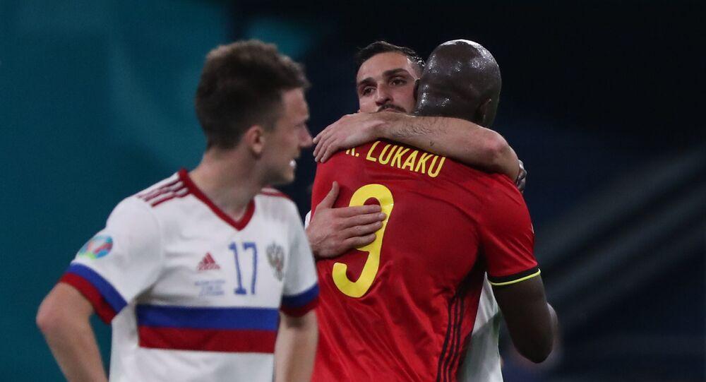 Belgium's Romelu Lukaku and Russia's Magomed Ozdoyev after the match