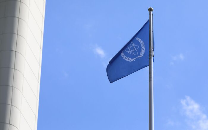 The flag of the International Atomic Energy Agency, IAEA waves at the entrance of the Vienna International Center in Vienna, Austria, Monday, June 7, 2021.