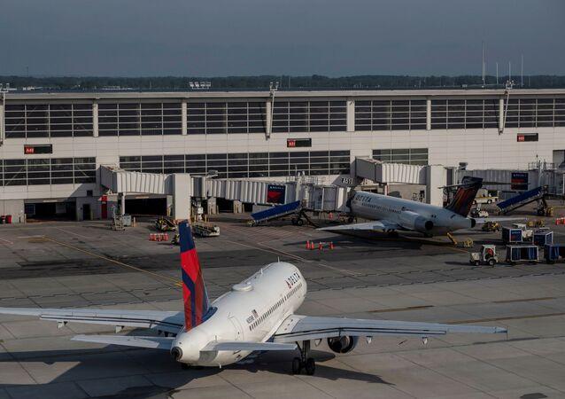 Delta Airlines passenger jets are docked at Detroit Metropolitan Wayne County Airport in Detroit, Michigan, U.S. June 12, 2021.