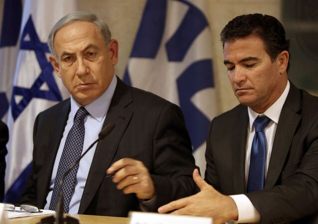 A file picture taken at the Israeli foreign ministry on October 15, 2015, shows Prime Minister Benjamin Netanyahu (L) sitting next to Yossi Cohen, who is currently the head of Israel's National Security Council, and who was named as the 12th head of the Mossad intelligence agency by Netanyahu on December 7, 2015.