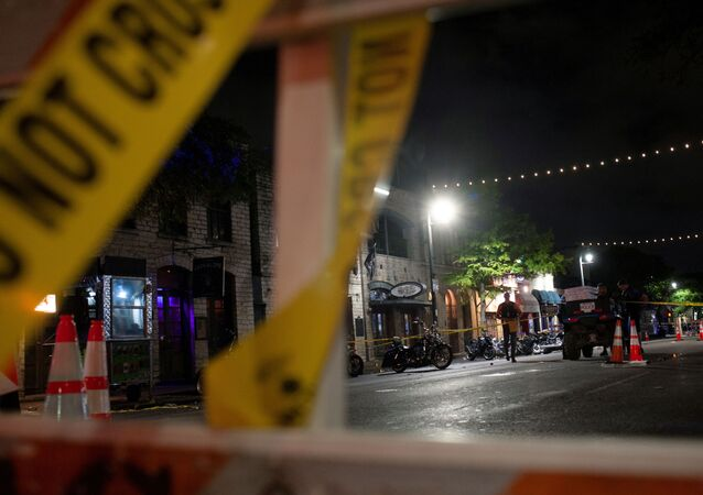 Police investigate the scene of a mass shooting in the Sixth Street entertainment district area of Austin, Texas, U.S. June 12, 2021.