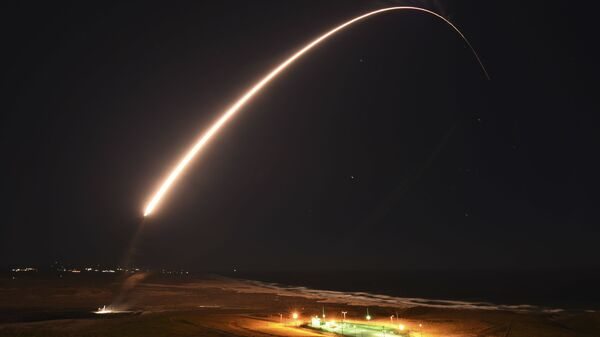 In this Feb. 23, 2021, file photo released by the U.S. Army Space and Missile Defense Command, an unarmed Minuteman 3 intercontinental ballistic missile launches during an operation test at Vandenberg Air Force Base, Calif. - Sputnik International