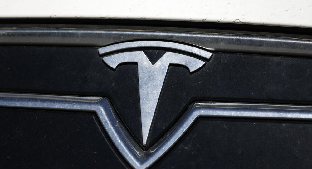 the company logo shones off the grille of an unsold 2020 Model S sedan at a Tesla dealership Sunday, July 19, 2020, in Littleton, Colo.