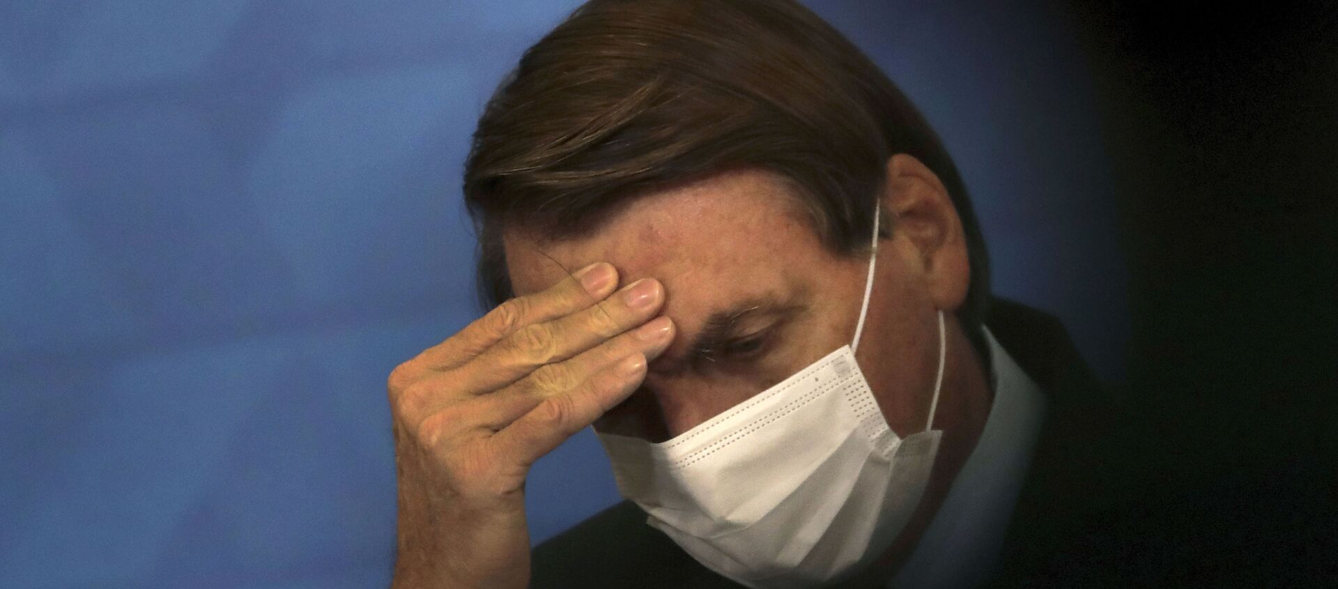 Brazil's President Jair Bolsonaro, wearing protective face mask, listens during a ceremony announcing economic measures to support philanthropic hospitals and help them treat COVID-19 patients, at the Planalto Presidential Palace, in Brasilia, Brazil, Thursday, March 25, 2021. - Sputnik International, 1920, 02.07.2021